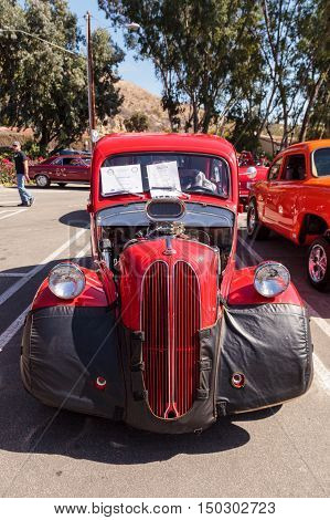 Laguna Beach, CA, USA - October 2, 2016: Red 1950 Ford Anglia Coupe owned by Robert Turek and displayed at the Rotary Club of Laguna Beach 2016 Classic Car Show. Editorial use.