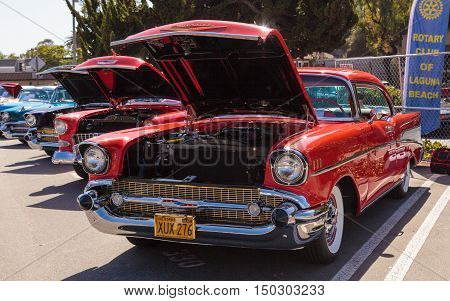 Laguna Beach, CA, USA - October 2, 2016: Red 1957 Chevrolet Bel Air 2 Door Hardtop owned by Len Yerkes and displayed at the Rotary Club of Laguna Beach 2016 Classic Car Show. Editorial use.