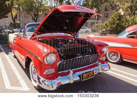 Laguna Beach, CA, USA - October 2, 2016: Red 1955 Chevrolet Bel Air 2 Door Hardtop owned by Dennis Katovsich and displayed at the Rotary Club of Laguna Beach 2016 Classic Car Show. Editorial use.