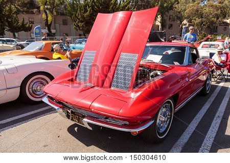Laguna Beach, CA, USA - October 2, 2016: Red 1963 Chevrolet Corvette owned by Tim and Gale Osborn and displayed at the Rotary Club of Laguna Beach 2016 Classic Car Show. Editorial use.