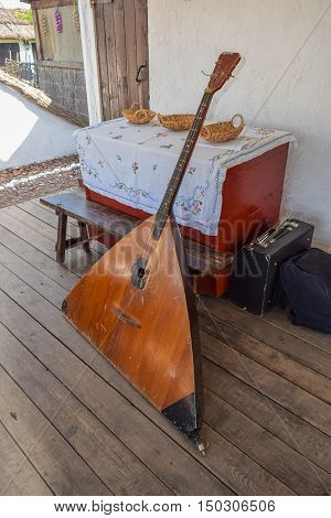Balalaika-contrabass Under A Canopy In A Cottage