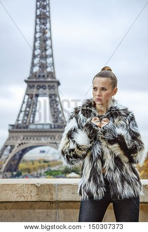 Fashion-monger In Front Of Eiffel Tower Looking Into Distance