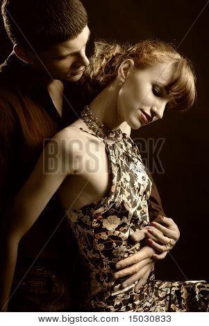 Man embrace woman