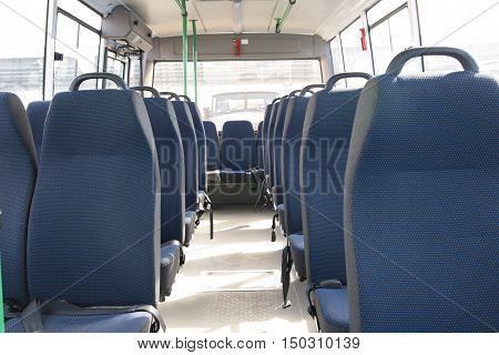 blue empty seats of a large passenger bus