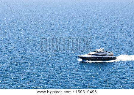 boat sailing on the blue sunny sea