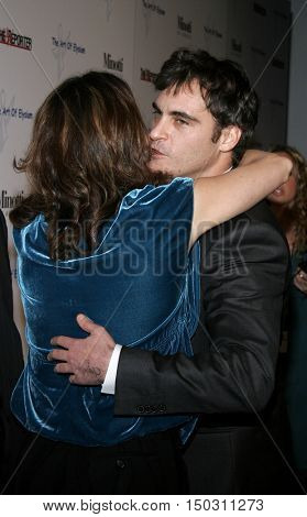 Jennifer Howell and Joaquin Phoenix at the Art of Elysium Presents Russell Young 'fame, shame and the realm of possibility' held at the Minotti in West Hollywood, USA on November 30, 2005.