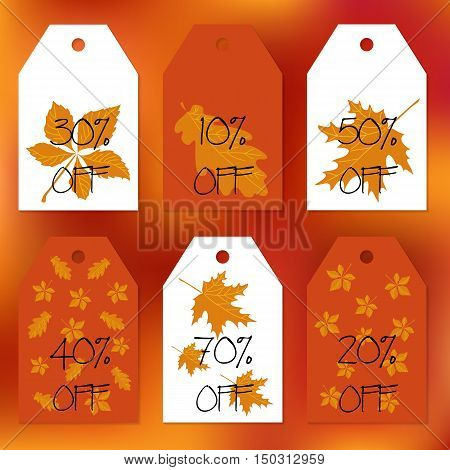 Set gift tags. Stock vector set for autumn sale. Abstract blurred orange background. Fall leafs. Text of percent discounts. You can place your text in the center. Congratulation invitation design cards.