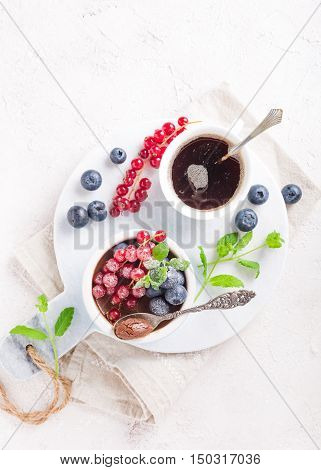 Delicious chocolate dessert with berries and mint served in ramekin. Top view. Copy space.