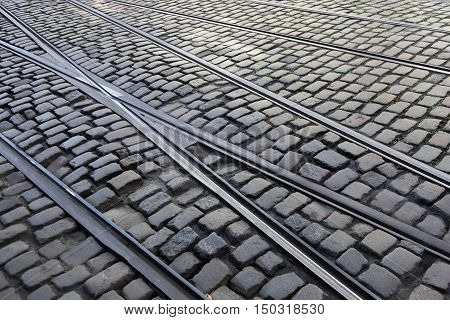crossing tram lines on cobblestone street in the flemish Belgian town of Ghent