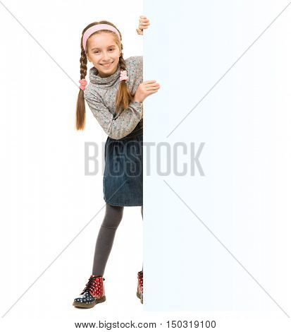 cute little girl peeking out from behind an empty blank for ad isolated on white background