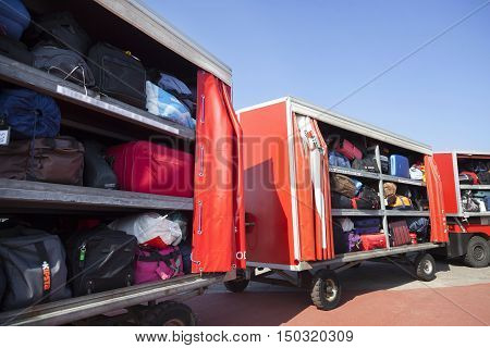 Holwerd, Netherlands, 23 september 2016: row of wagons full of suitcases and other luggage under blue sky