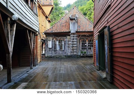 BERGEN, NORWAY - JULY 2, 2016: Quarter Bryggen is a special mini-city with winding streets wooden flooring underfoot and interesting architecture.