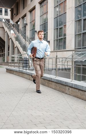 Businessman With A Briefcase Running