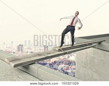 business man walk on danger improvised bridge