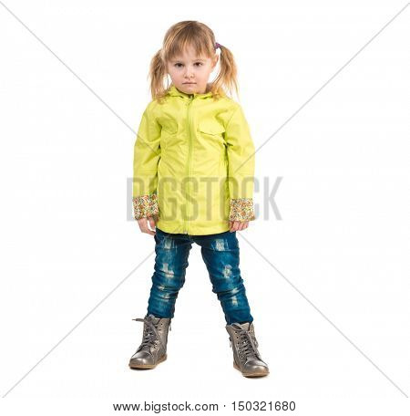 serious little girl in yellow coat isolated on white background
