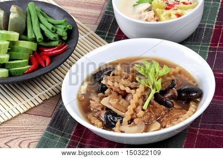 Close up of  mixed vegetable and tofu sheet in brown soup call