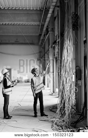 Maintenance Engineers checking electricity, black and white