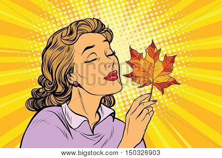 Girl and autumn, a woman with red maple leaf. pop art retro vector illustration. The seasons of nature