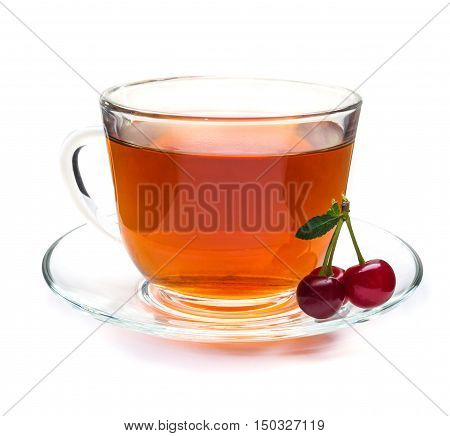 Red cherry and transparent cup of herbal tea isolated on white background