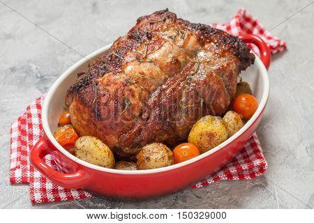 Boneless Pork Loin Roast with Potatoes and Tomatoes