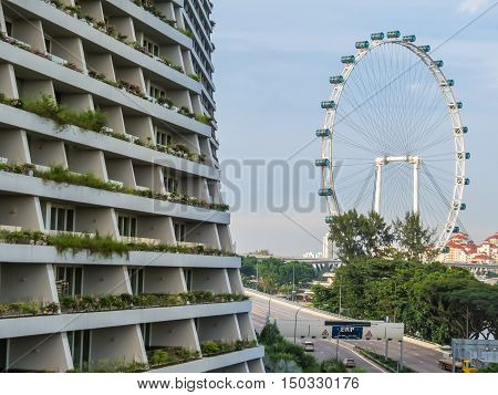 SINGAPORE, REPUBLIC OF SINGAPORE - JANUARY 09, 2014: Marina Bay Sands Singapore Hotel with Infinity Pool and Singapore Flyer
