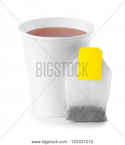 black tea in takeaway cup with tea bag isolated on white background. Opened take-out paper cup of tea isolated on white. Black tea
