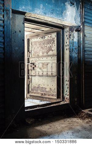 Blue Rusted Metal Wall And Open Heavy Steel Door