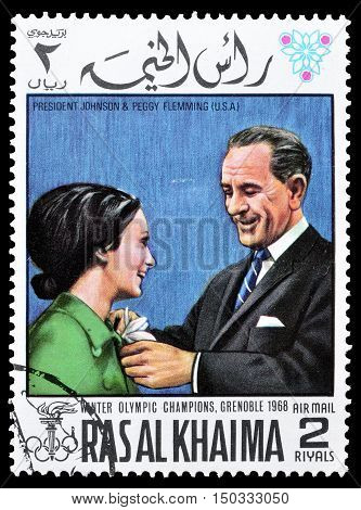 RAS AL KHAIMA - CIRCA 1968 : Cancelled postage stamp printed by Ras Al Khaima, that shows  President Johnson and Peggy Flemming.