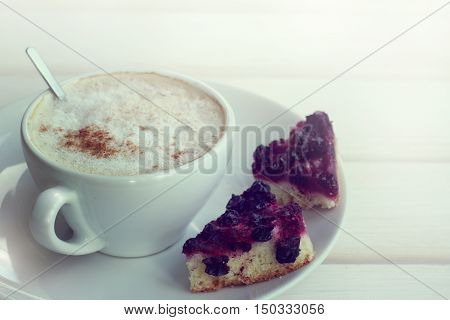 frothy cappuccino with pastries in the shape of a heart / favorite coffee break