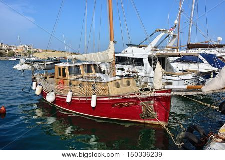 Lavrion Greece - Sept 18 2016: Vintage red sailing yacht moored in marina. Greece very popular place of destination for spending time during vacation