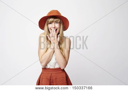 Surprised model in fashionable clothes white background