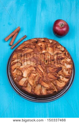 apple cake on a turquoise wooden background