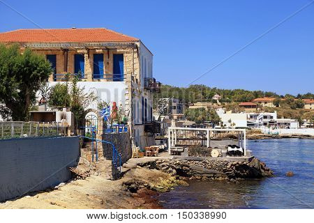 Old houses and tavern on sea coast in habour near Rethymno, Crete, Greece