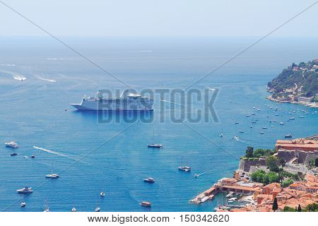 colorful coast and turquiose water with boats and ships, cote dAzur Provence, France