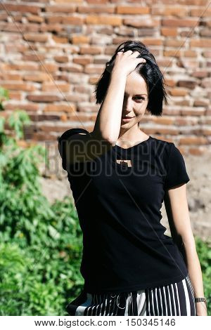 Pretty Girl Tidies Brunette Hair