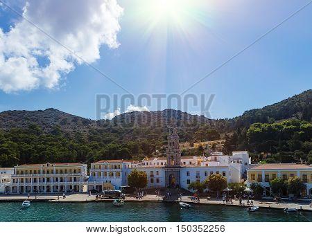 panormitis monastery in Symi island , sun clouds, Greece