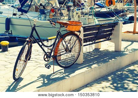 Painted Bicycle on Embankment of Simi, Greece, Retro Effect