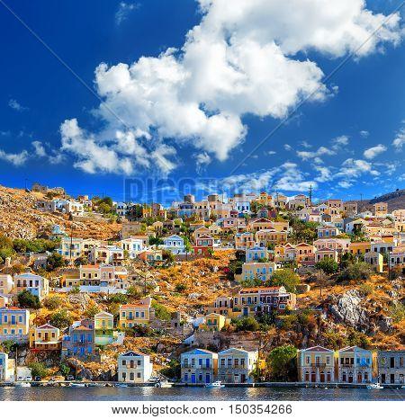 Wonderful Greece. Island Symi dollhouses cloud bright day