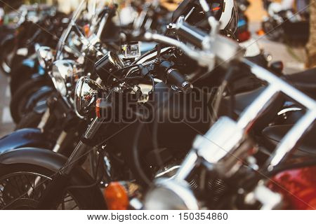 close-up of motos parked in line at exhibition