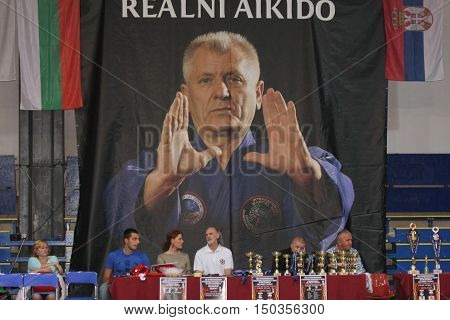 BELGRADE,SERBIA - SEPTEMBER 24, 2016: referee table and poster of Ljubomir Vracarevic ,founder of real aikido at the opening of martial arts evening