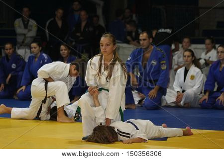 BELGRADE,SERBIA - SEPTEMBER 24, 2016: Young girls and boys demonstrate actions at martial arts evening