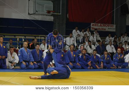 BELGRADE, SERBIA - SEPTEMBER 24, 2016: Fighters demonstrate actions at martial arts evening
