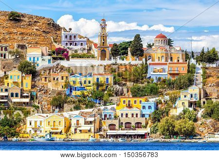 Colourful buildings and Church on beautiful summers day at Symi Town Greece Europe