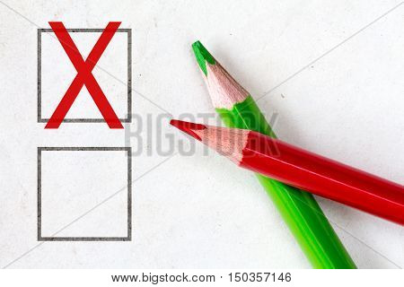 Red and green pencils with marking checkbox. Concept for customer satisfaction surveyeducation research or election