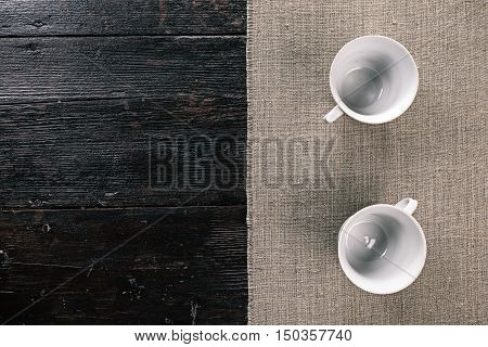 Still life with two empty tea cups on the half covered table. Flat lay