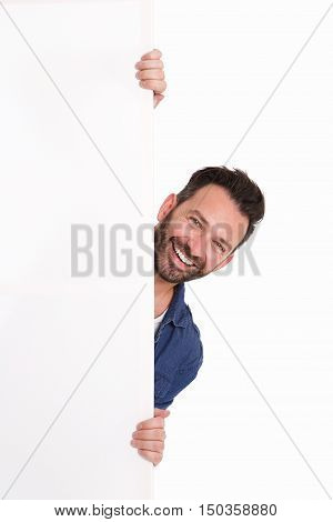 Smiling Mature Man Peeking Over Blank Poster Sign