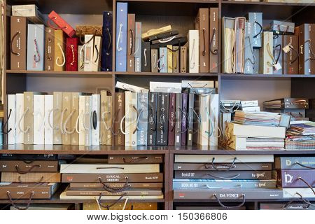 MOSCOW, RUSSIA - JUN 27, 2016: Shelves with samples catalogues in salon of Uyut (Comfort) Company. Company offers high-quality products for windows decoration.