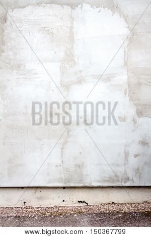 Aged weathered gray street plaster wall background