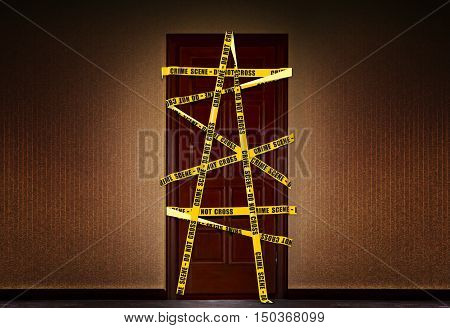 Dramatic image of a closed door in the house, which is blocked by yellow police tape with the requirement not to enter