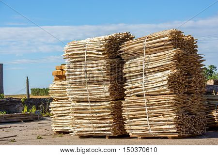 Stack Of Wooden Fence Posts